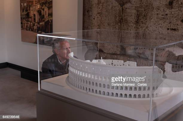 A visitor observes the model of a Carlo Fontana project for a church inside the Colosseum built in 1725 during a press preview of the exhibition...