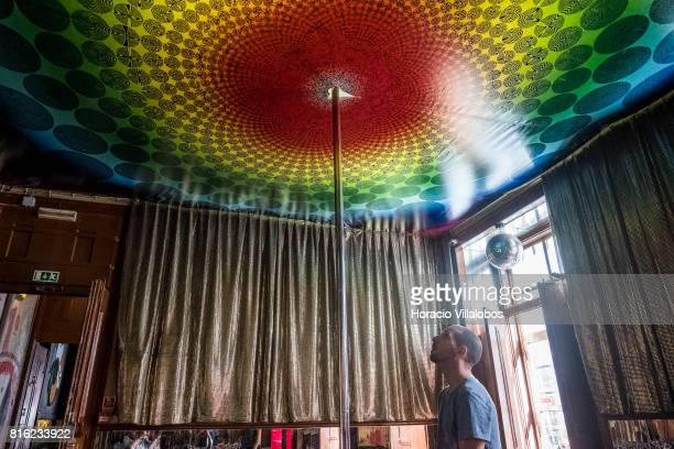 A visitor observes the pole dancing room decorated ceiling at 'Pensao Amor' on July 14 2017 in Lisbon Portugal 'Pensao Amor' used to be a five floors...