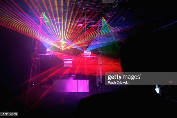 A visitor of the International Musikmesse watches a lasershow on March 30 2006 in Frankfurt Germany At the 27th Frankfurt Music Show the world's...