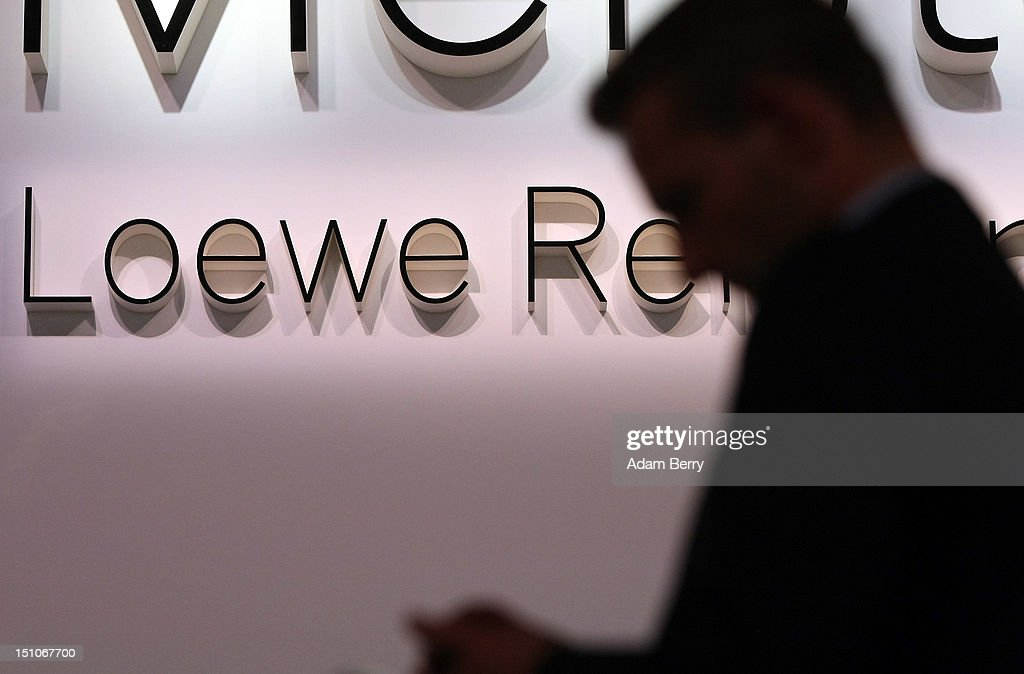 A visitor passes a Loewe logo during the Internationale Funkausstellung (IFA) 2012 consumer electronics trade fair on August 31, 2012 in Berlin, Germany. Microsoft, Samsung, Sony, Panasonic and Philips are amongst many of the brands showcasing their latest consumer electronics hardware, software and gadgets to members of the public from August 31 to September 5.