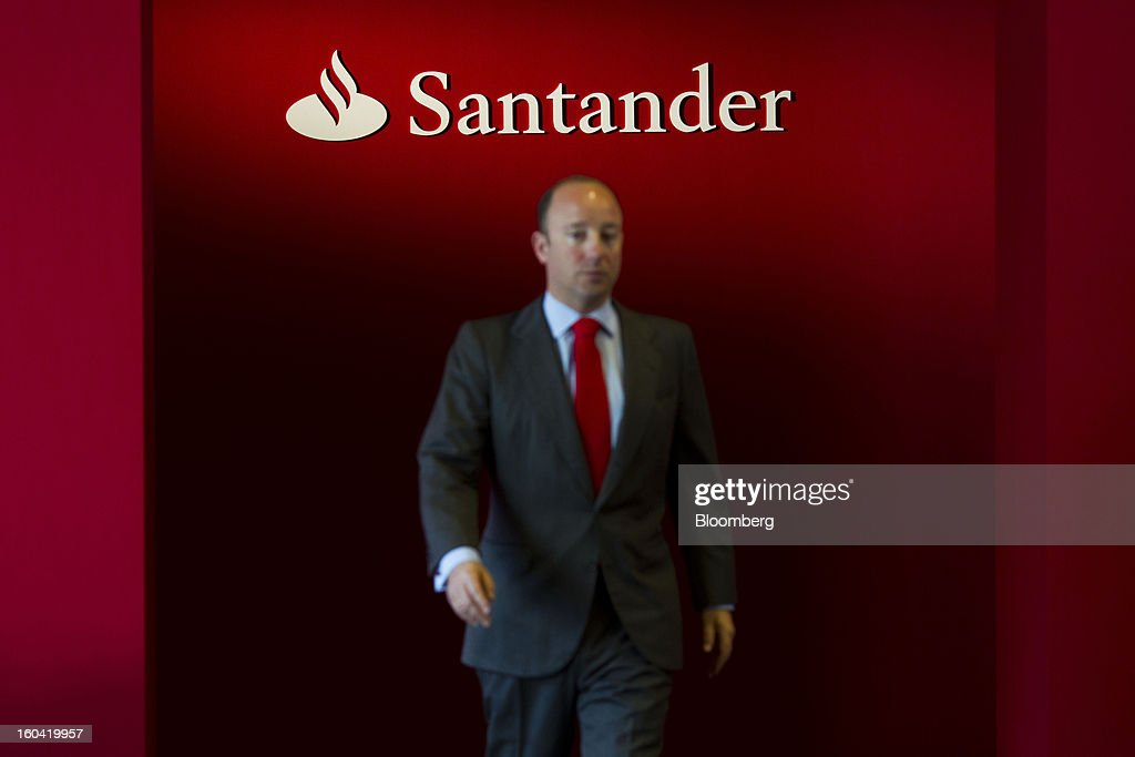 A visitor passes a logo on display at the Banco Santander SA fourth-quarter results news conference in Madrid, Spain, on Thursday, Jan. 31, 2013. Banco Santander SA posted a fourth-quarter profit that missed analyst estimates as Spain's biggest lender set aside money for further loan losses in its home market and earnings slumped in Brazil and Britain. Photographer: Angel Navarrete/Bloomberg via Getty Images