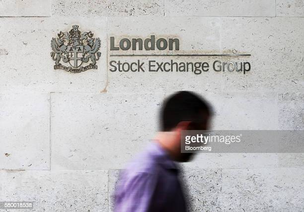 A visitor passes a London Stock Exchange sign as he enters the London Stock Exchange Group Plc's offices in Paternoster Square in London UK on Monday...