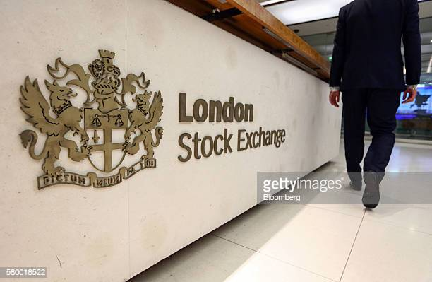 A visitor passes a London Stock Exchange sign at the London Stock Exchange Group Plc's offices in Paternoster Square in London UK on Monday July 25...