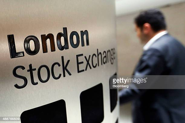A visitor passes a London Stock Exchange sign inside the main atrium of the London Stock Exchange Group Plc's headquarters in London UK on Thursday...