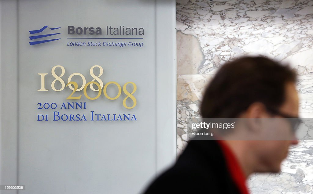 A visitor passes a plaque commemorating the 200th anniversary of the Borsa Italiana, inside Italy's stock exchange, which is part of the London Stock Exchange Group Plc, in Milan, Italy, on Thursday, Jan. 17, 2013. The euro-area economy won't return to growth until the next quarter as a recovery in Italy is delayed and France continues to shrink, according to a survey of economists. Photographer: Alessia Pierdomenico/Bloomberg via Getty Images
