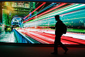 A visitor passes a video display showing Tower Bridge in London UK in the Accenture Plc pavilion at the Mobile World Congress in Barcelona Spain on...