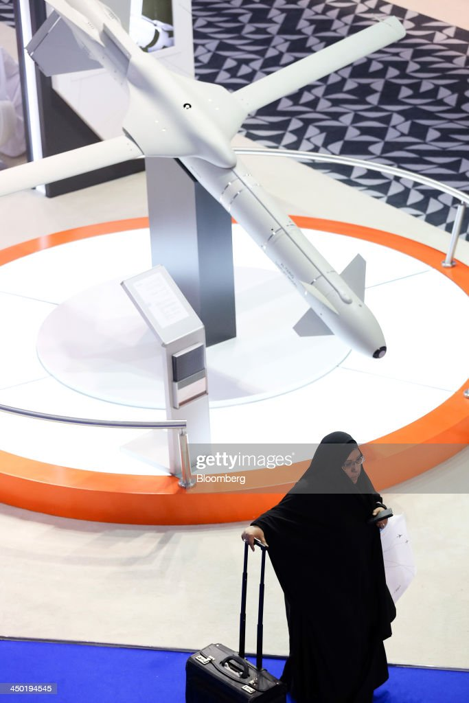 A visitor passes an Al-Tarqi high performance bomb, produced by Tawazun Holding, seen on display at the company's stand during the 13th Dubai Airshow at Dubai World Central (DWC) in Dubai, United Arab Emirates, on Sunday, Nov. 17, 2013. The 13th edition of the biennial 2013 Dubai Airshow, the Middle East's leading aerospace event organized by F&E Aerospace. Photographer: Duncan Chard/Bloomberg via Getty Images