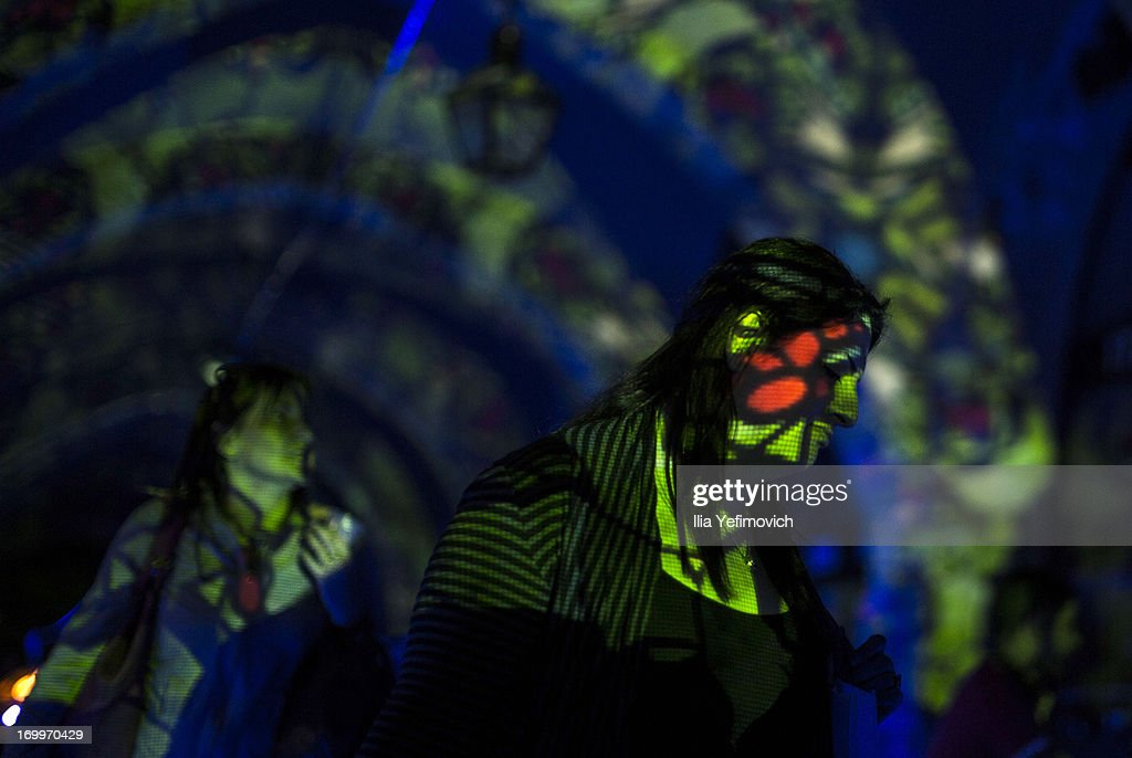 A visitor passes by a light installation during the annual Jerusalem Festival of Light on June 5, 2013 in Jerusalem, Israel. During the festival light installations are projected onto the historic buildings of Jerusalem's Old City.