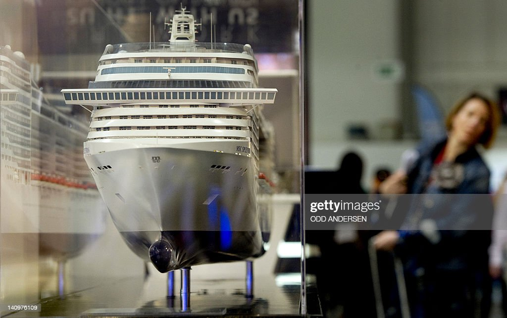 A visitor passes by the model of a cruise ship at the a cruising company booth at the ITB international tourism fair in Berlin on March 9, 2012. The ITB travel trade show, with 10,644 exhibitors from 187 countries, is due to run until March 11.
