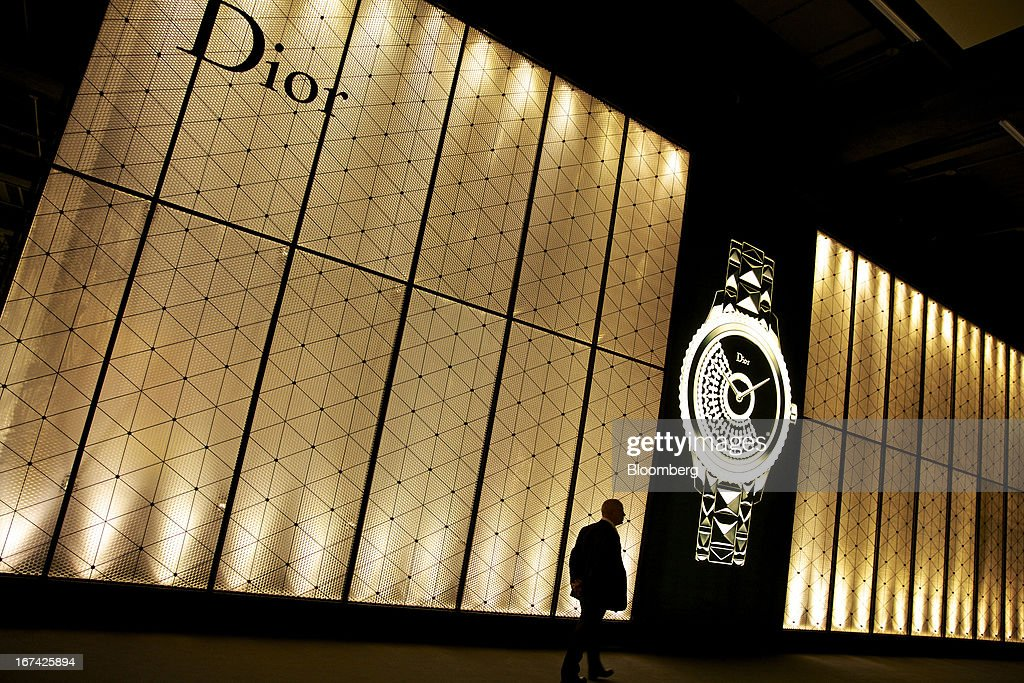 A visitor passes the Christian Dior SA booth during the Baselworld watch fair in Basel, Switzerland, on Thursday, April 25, 2013. The annual fair attracts 2,000 companies from the watch, jewelry and gem industries to show their new wares to more than 100,000 visitors. Photographer: Gianluca Colla/Bloomberg via Getty Images