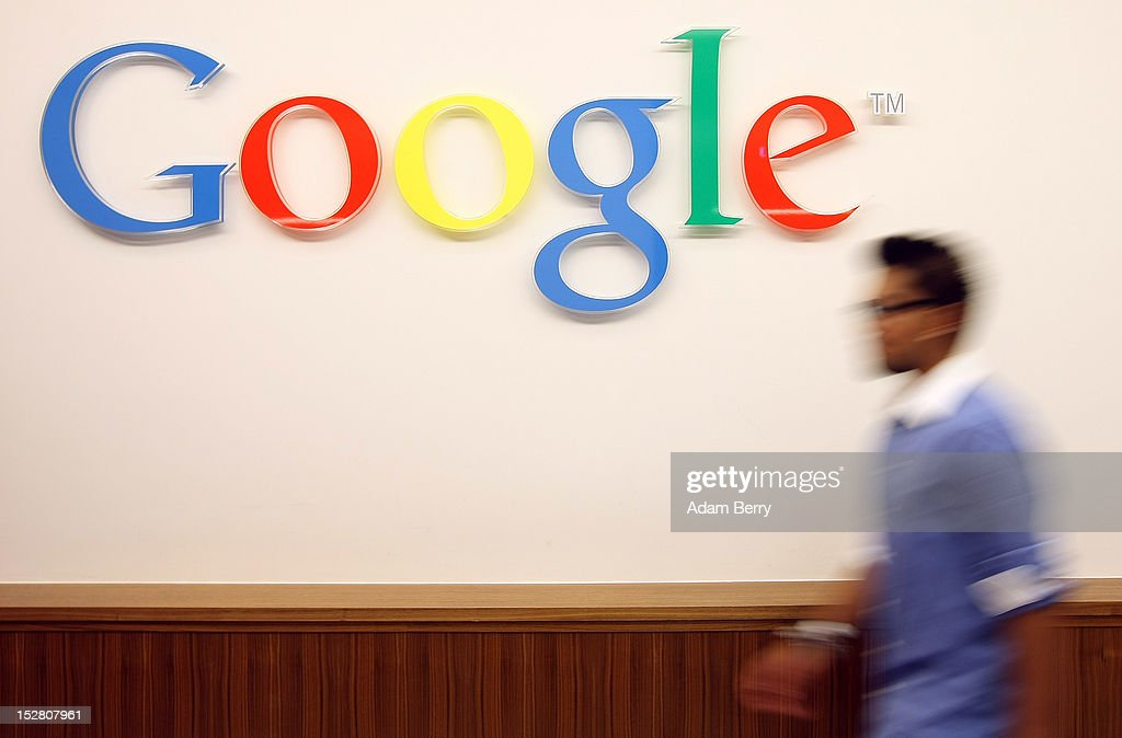 A visitor passes the Google logo on September 26 2012 at the official opening party of the Google offices in Berlin Germany Although the American...