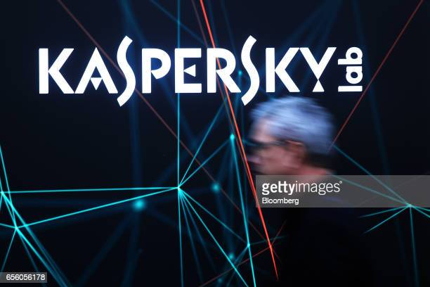 A visitor passes the Kaspersky Lab pavilion at the CeBIT 2017 tech fair in Hannover Germany on Tuesday March 21 2017 Leading edge technologies in the...