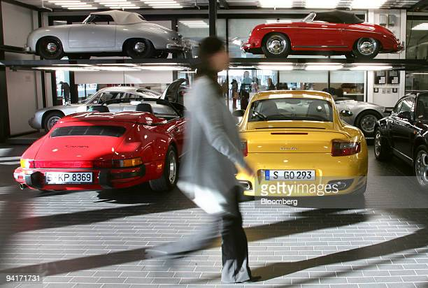 A visitor passes through the repair shop in the Porsche Museum in Stuttgart Germany on Wednesday Dec 9 2009 Volkswagen AG Europe's largest automaker...