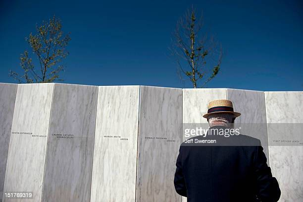 A visitor pauses in front of the Wall of Names while Vice President Joseph Biden speaks at the Flight 93 National Memorial during observances...