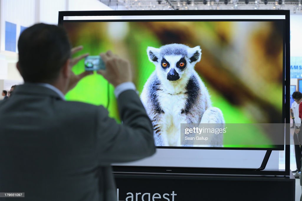 A visitor photographs a 100' UltraHD 4000K television at the Samsung stand at the IFA 2013 consumer electronics trade fair on September 5, 2013 in Berlin, Germany. The 2013 IFA will be open to the public from September 6-11.