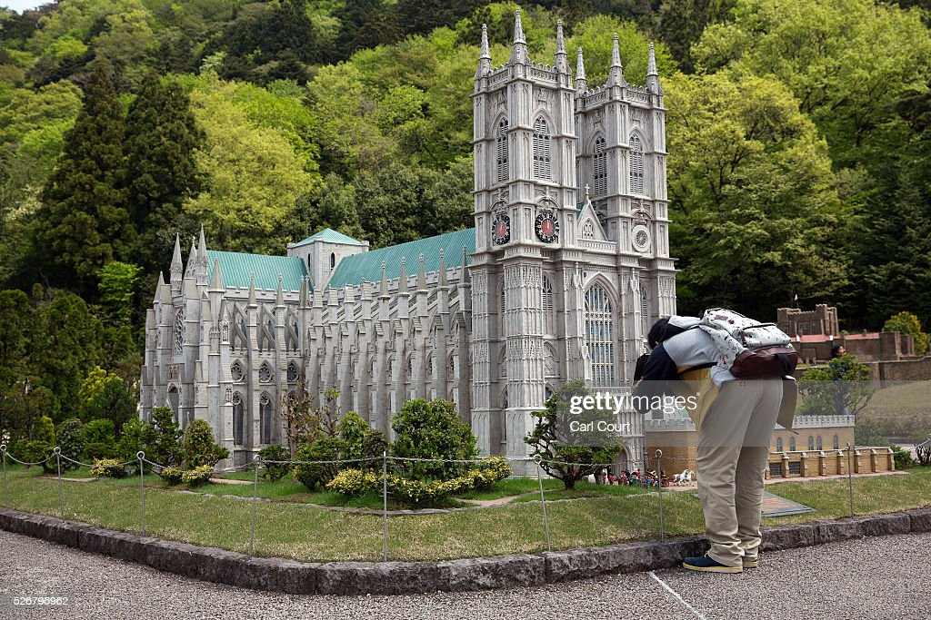 A visitor photographs a scale model of Westminster Abbey at Tobu World Square theme park on May 01, 2016 in Nikko, Japan. Tobu World Square contains over a hundred 1:25 scale models of famous buildings, including World Heritage Sites, complete with 140,000 1:25 miniature people and receives visitors from around the world.