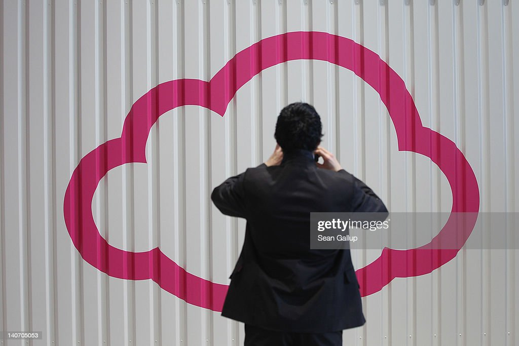 A visitor photographs a symbol of a cloud at the Deutsche Telekom stand the day before the CeBIT 2012 technology trade fair officially opens to the public on March 5, 2012 in Hanover, Germany. CeBIT 2012, the world's largest information technology trade fair, will run from March 6-10, and advances in cloud computing are a major feature this year.