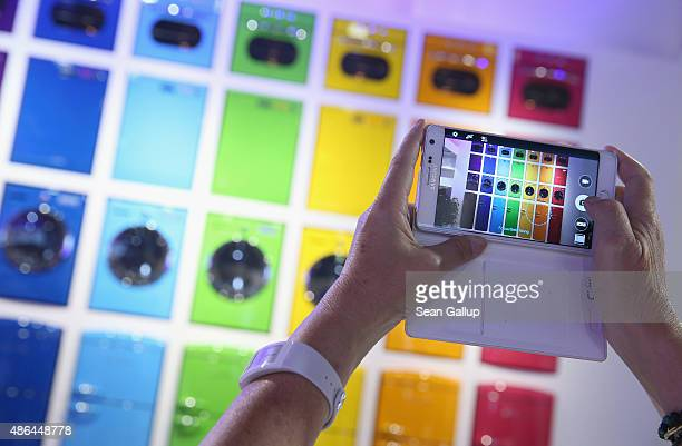 A visitor photographs an array of home appliances at the Vestel stand at the 2015 IFA consumer electronics and appliances trade fair on September 4...