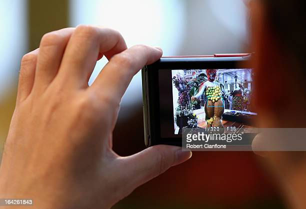 A visitor photographs an exhibit at the 18th annual International Flower and Garden Show held at the Royal Exhibition Building and the surrounding...
