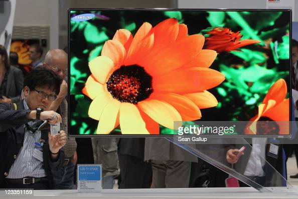 A visitor photographs an LED television at the Samsung hall at the IFA 2011 consumer electonics and appliances trade fair on the first day of the...