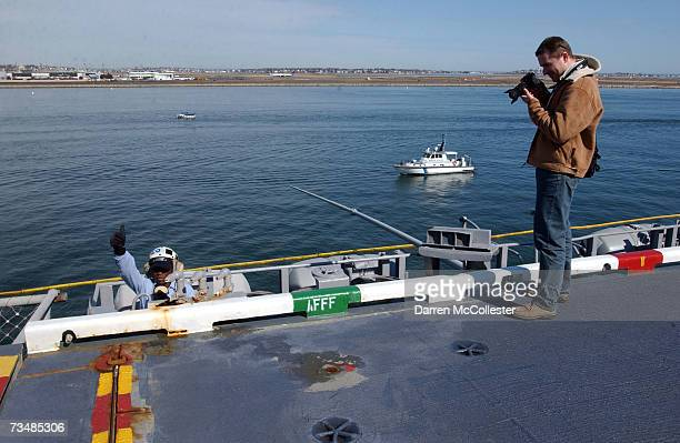 A visitor photographs Aviation Boatswain Handler Nyra Rodgers on board the USS John F Kennedy March 3 2007 during a last port call in Boston...