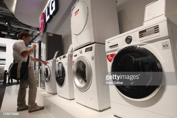 A visitor photographs hightech washing machines at the LG stand at the IFA 2011 consumer electonics and appliances trade fair on the first day of the...