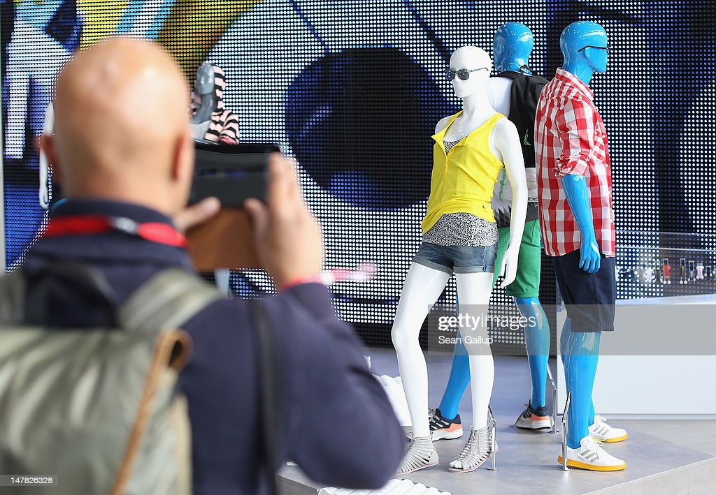 A visitor photographs the adidas Originals Spring/Summer 13 collection at the Bread and Butter 2012 fashion trade fair on July 4, 2012 in Berlin, Germany.