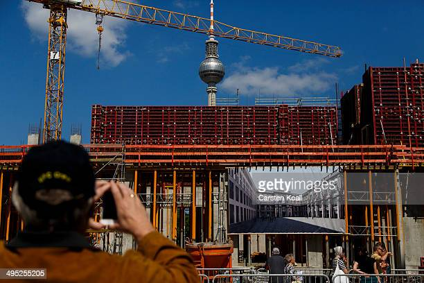 A visitor photographs the construction work of the Berlin City Palace in Berlin's city center during a public day on June 1 2014 in Berlin Germany...