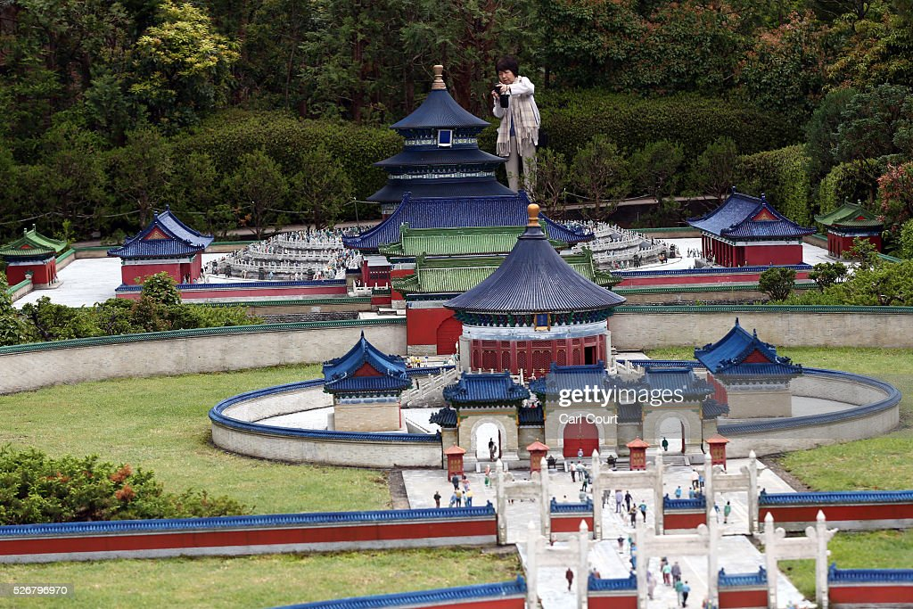 A visitor photographs the Temple of Heaven at Tobu World Square theme park on May 01, 2016 in Nikko, Japan. Tobu World Square contains over a hundred 1:25 scale models of famous buildings, including World Heritage Sites, complete with 140,000 1:25 miniature people and receives visitors from around the world.