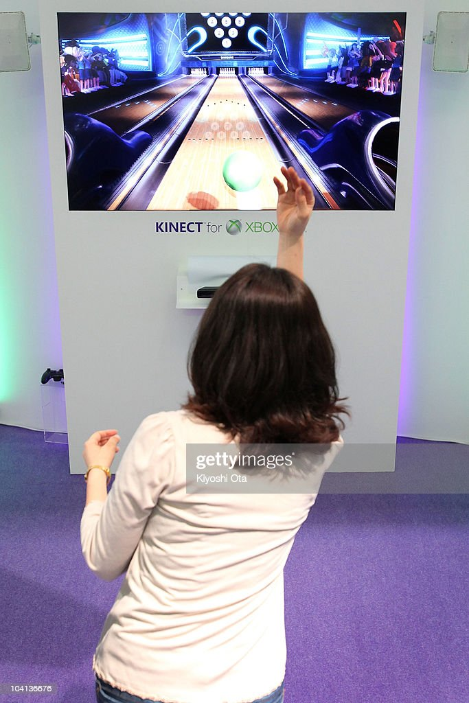 A visitor plays 'Kinect Sports' using Microsoft Corp.'s Kinect hands-free motion-controlled device on the Xbox 360 video game console during the Tokyo Game Show 2010 at Makuhari Messe on September 16, 2010 in Chiba, Japan. The computer and video game convention, which will be held until September 19, features exhibitions of upcoming game software and hardware from 194 companies and organizations to draw business visitors and the general public.