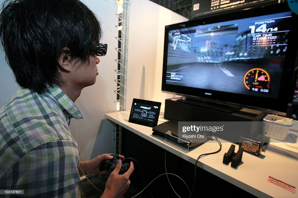A visitor plays Namco Bandai Games Inc.'s 'Ridge Racer 7' on Sony Computer Entertainment Inc.'s 3D-supported PlayStation 3 (PS3) video game console during the Tokyo Game Show 2010 at Makuhari Messe on September 16, 2010 in Chiba, Japan. The computer and video game convention, which will be held until September 19, features exhibitions of upcoming game software and hardware from 194 companies and organizations to draw business visitors and the general public.