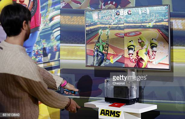 A visitor plays the Arms video game on a Nintendo Switch games console during the new console's unveiling by Nintendo Co on January 13 2017 in Paris...
