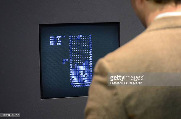 A visitor plays the video game Tetris during an exhibition preview featuring 14 video games acquired by The Museum of Modern Art in New York March 1...