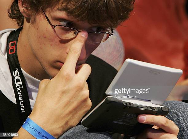 A visitor plays with a Nintendo DS portable at the Computer Gaming Convention on August 18 2005 in Leipzig Germany The convention is Germany's...