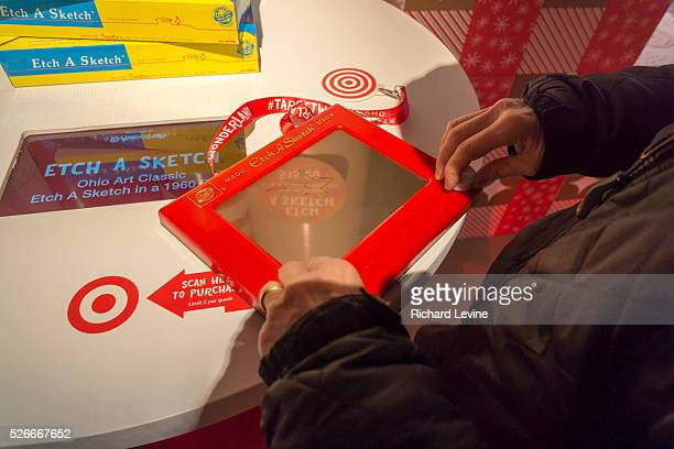 A visitor plays with an EtchASketch in the Target 'Wonderland' popup store in the Meatpacking District in New York on Wednesday December 9 2015 Ohio...