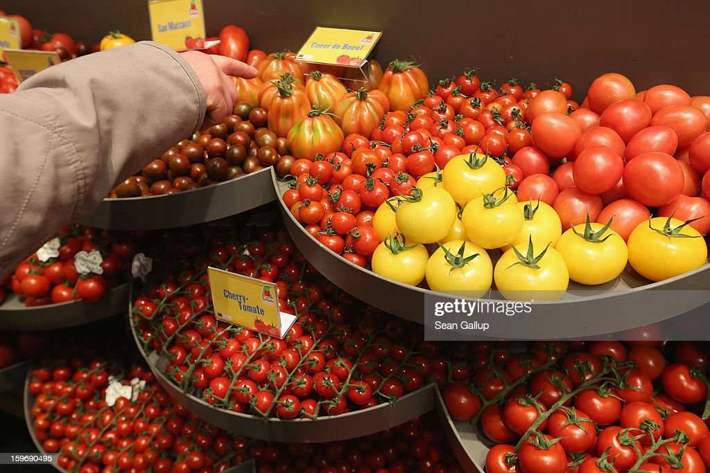 A visitor points to different types of tomatoes from Holland lying on display at a Dutch vegetable stand at the 2013 Gruene Woche agricultural trade fair on January 18, 2013 in Berlin, Germany. The Gruene Woche, which is the world's largest agricultural trade fair, runs from January 18-27, and this year's partner country is Holland.