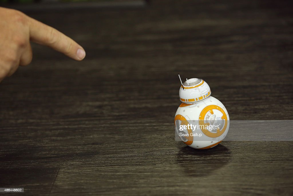 A visitor points to the Sphero BB-8 Star Wars droid at the Sphero stand at the 2015 IFA consumer electronics and appliances trade fair on September 4, 2015 in Berlin, Germany. The 2015 IFA will be open to the public from September 4-9.
