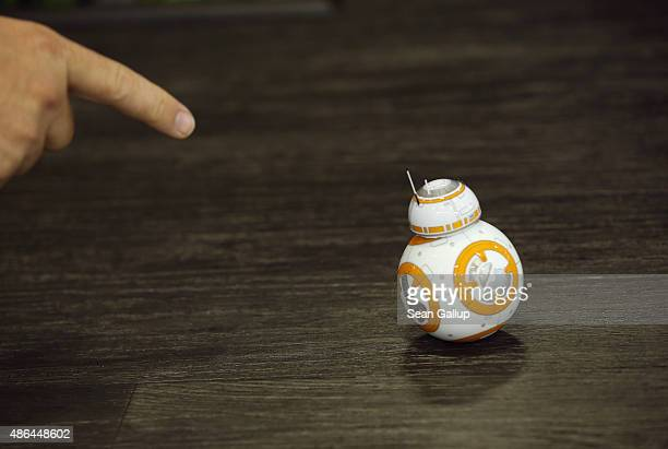 A visitor points to the Sphero BB8 Star Wars droid at the Sphero stand at the 2015 IFA consumer electronics and appliances trade fair on September 4...