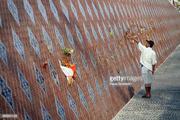 A visitor points to the wall of rememberance at the Baan Nam Kem Memorial Tsunami park January 13 2006 in Khao Lak Thailand Over a year after the...
