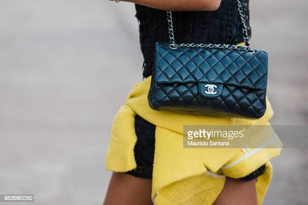 A visitor poses fashion detail Chanel purse during Sao Paulo Fashion Week N43 SPFW Summer 2017 on March 15 2017 in Sao Paulo Brazil