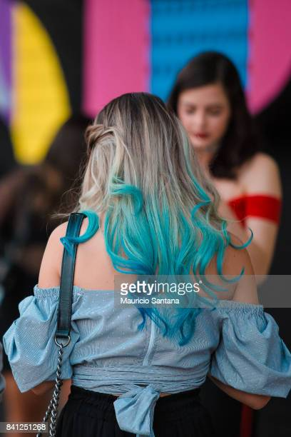 A visitor poses fashion detail colored hair and hairstyle during Sao Paulo Fashion Week N44 SPFW Winter 2018 at Ibirapuera's Bienal Pavilion on...