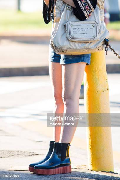 A visitor poses fashion detail shoes and shoulder bag during Sao Paulo Fashion Week N44 SPFW Winter 2018 at Ibirapuera's Bienal Pavilion on August 28...