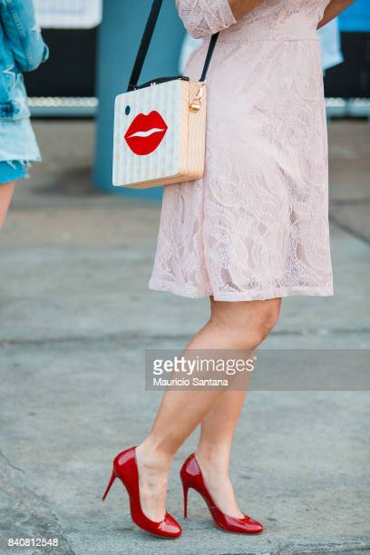 A visitor poses fashion detail shoulder bag and shoes during Sao Paulo Fashion Week N44 SPFW Winter 2018 at Ibirapuera's Bienal Pavilion on August 29...