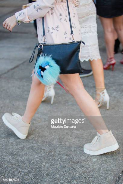 A visitor poses fashion detail shoulder bag during Sao Paulo Fashion Week N44 SPFW Winter 2018 at Ibirapuera's Bienal Pavilion on August 28 2017 in...