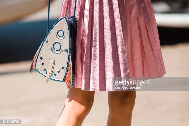 A visitor poses fashion detail shoulder bag during Sao Paulo Fashion Week N44 SPFW Winter 2018 at Ibirapuera's Bienal Pavilion on August 30 2017 in...