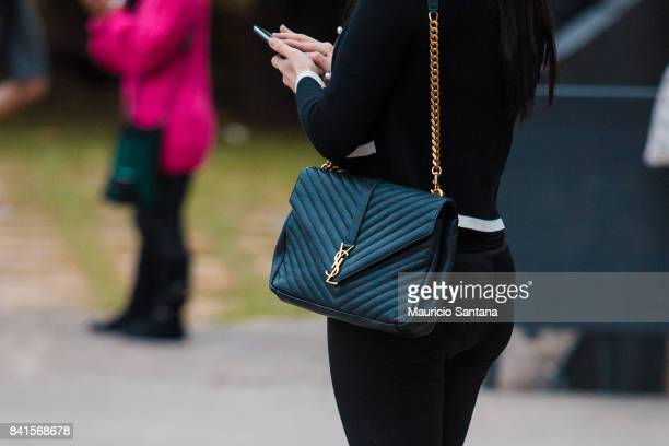 A visitor poses fashion detail shoulder bag during Sao Paulo Fashion Week N44 SPFW Winter 2018 at Ibirapuera's Bienal Pavilion on August 31 2017 in...