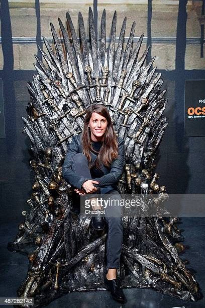 A visitor poses on the throne of the TV serie 'Games of Thrones' during the opening of an exhibition dedicated to HBO's television medieval fantasy...
