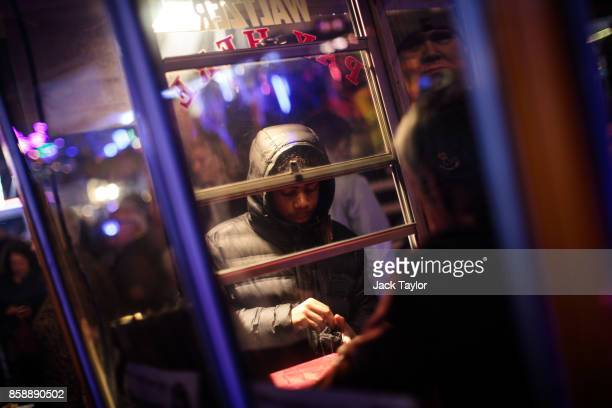 A visitor purchases a ticket for a ride at the Nottingham Goose Fair in the Forest Recreation Ground on October 7 2017 in Nottingham England The...