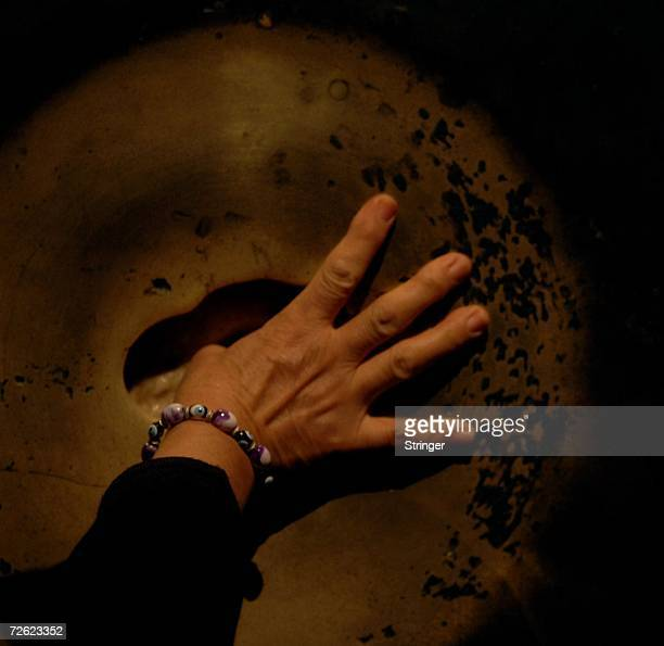 A visitor puts her thumb into the wishing hole on a marble column inside the 6th century Byzantine monument of St Sophia on November 16 2006 in the...