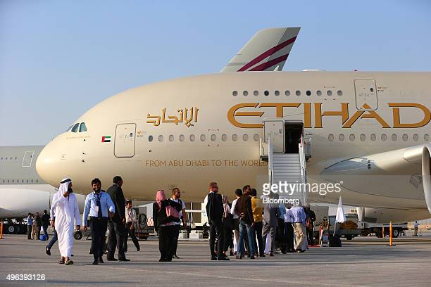 Visitor queue to access an Airbus A380800 aircraft operated by Etihad Airways on the second day of the 14th Dubai Air Show at Dubai World Central in...